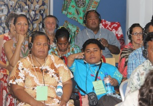 Picture of representatives from Fusi Alofa Association (Tuvalu), Te Toa Matoa (Kiribati) and from Nauru DPA at a conference wearing headphones to listen to the translation of a speech.
